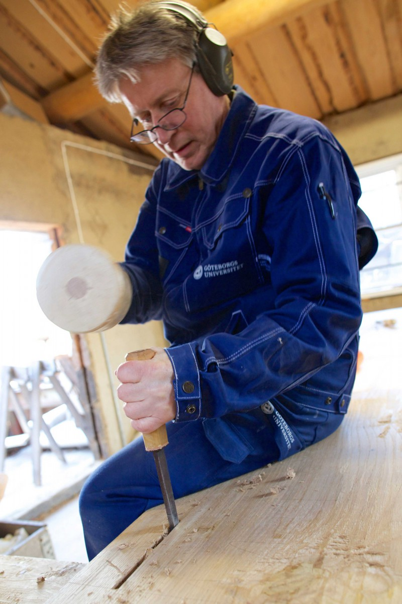 Tomas Karlsson makes a hole for one of the legs on a workbench in Mariestad.